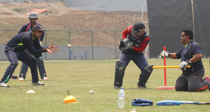 Consultant coach Pubudu Dassanayake lends catching lesson to Nepal national cricket team players during a training session at the TU Stadium, on Friday, April 15, 2016. Nepal face Namibia in the World Cricket League Championship match on Saturday. Photo: THT