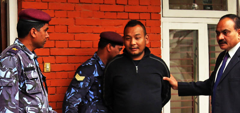 Nepal Police's CIB officials parading the murder suspect Tashi Gurung. Photo: RSS