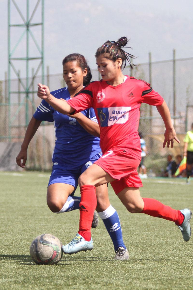 NPC's Nisha Sunar (right) vies for the ball against Ranjana Chaudhari of Eastern during their Women's League Football Tournament in Lalitpur on Tuesday. Photo: THT