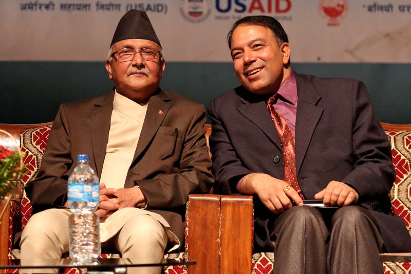 Prime Minister KP Sharma Oli (left) interacts with the National Reconstruction Authority (NRA) Chairman Sushil Gyawali during a closing ceremony of a two-day training programme organised by the NRA to bid farewell to the engineers that were deployed to reconstruct the houses for quake victims, on Wednesday, April 28, 2016. Photo: RSS