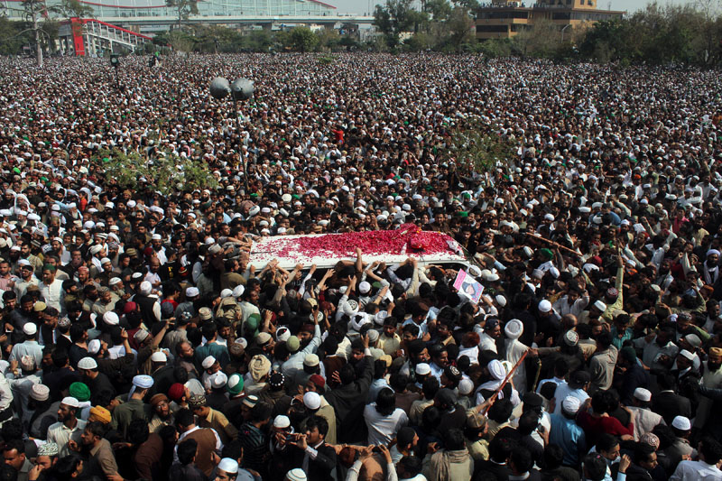 FILE- Thousands of people attend a funeral of Pakistani police officer Mumtaz Qadri, the convicted killer of a former governor, in Rawalpindi, Pakistan, on March 1, 2016. Photo: AP