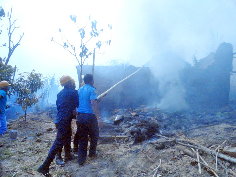 Locals and police personnel douse fire in Syabrumba-2 of Panchthar district on Monday, April 25, 2016. Photo: Laxmi Gautam