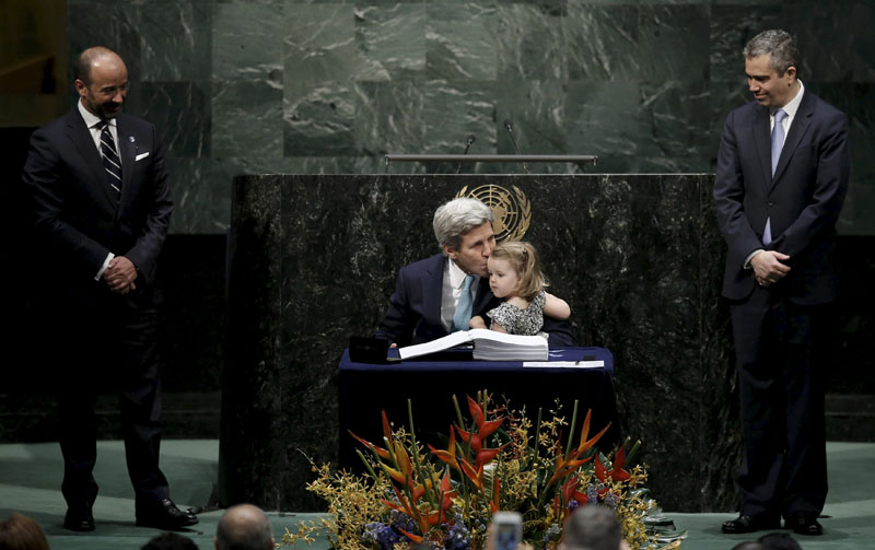 US Secretary of State John Kerry kisses his two-year-old granddaughter Isabelle Dobbs-Higginson after signing the Paris Agreement on climate change at United Nations Headquarters in Manhattan, New York, US, on April 22, 2016. Photo: Mike Segar/Reuters