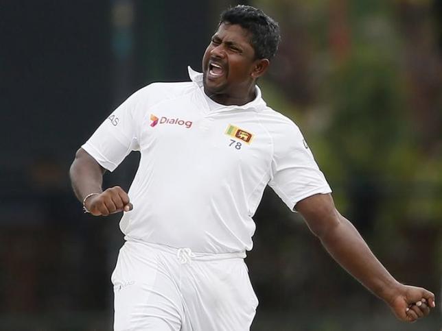 Sri Lanka's Rangana Herath celebrates in test cricket match in Colombo October 26, 2015. REUTERS/Dinuka Liyanawatte/Files