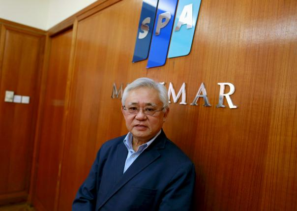 Yoma Chairman Serge Pun poses for a photograph in his office in Yangon, Myanmar March 24, 2014.  REUTERS/Soe Zeya Tun/File Photo