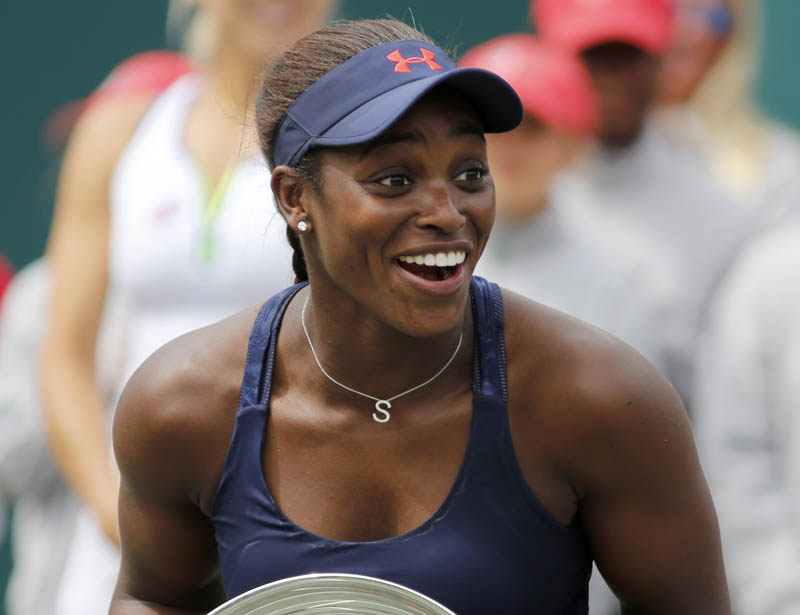 Sloane Stephens of the United States holds the trophy after wining the Volvo Car Open in Charleston on Sunday. Photo: AP