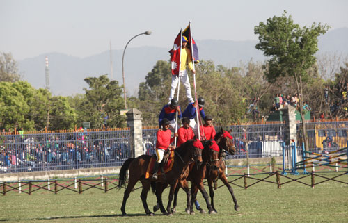 Carnival of Horses: Nepal Army personnel demonstrating a stunt at the Ghode Jatra ceremony at the NA Pavilion in Kathmanduu201a on Sundayu201a March 30u201a 2014.  Photo: THT Filen
