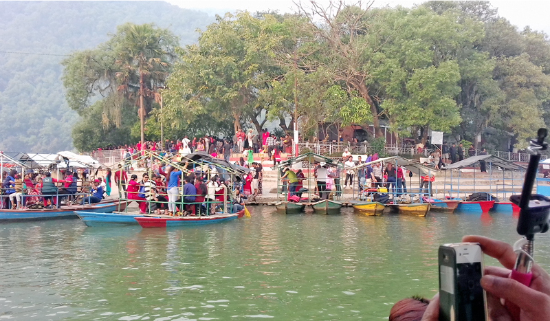 Visitors throng Talbarahi temple at the mid of the Phewa Lake in Pokhara, on the occasion of New Year 2073, Wednesday, April 13, 2016. Photo: RSS
