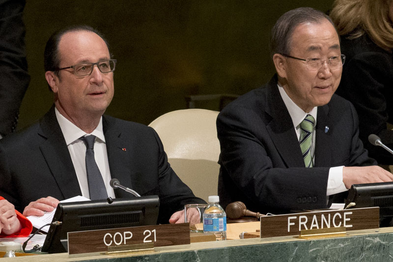 United Nations Secretary General Ban Ki-moon, (right) and French President Francois Hollande attend the Paris Agreement on climate change ceremony, on Friday, April 22, 2016 at UN headquarters. Photo: Mary Altaffer/AP