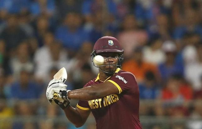 West Indies Johnson Charles plays a shot against India in the semi-final.  REUTERS
