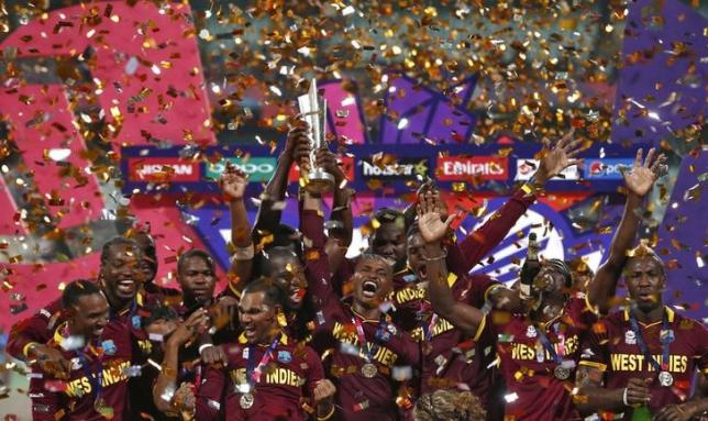 Cricket - England v West Indies - World Twenty20 cricket tournament final - Kolkata, India - 03/04/2016. West Indies players celebrate with the trophy after winning the final.   REUTERS/Adnan Abidi