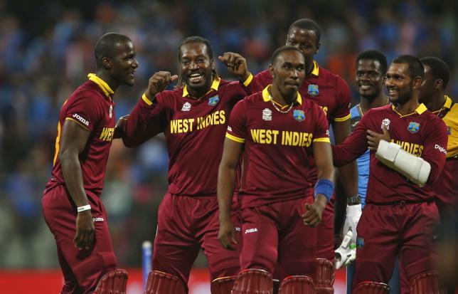 Cricket - West Indies v India - World Twenty20 cricket tournament semi-final - Mumbai, India - 31/03/2016. West Indies players celebrate after winning their match.   REUTERS/Danish Siddiqui