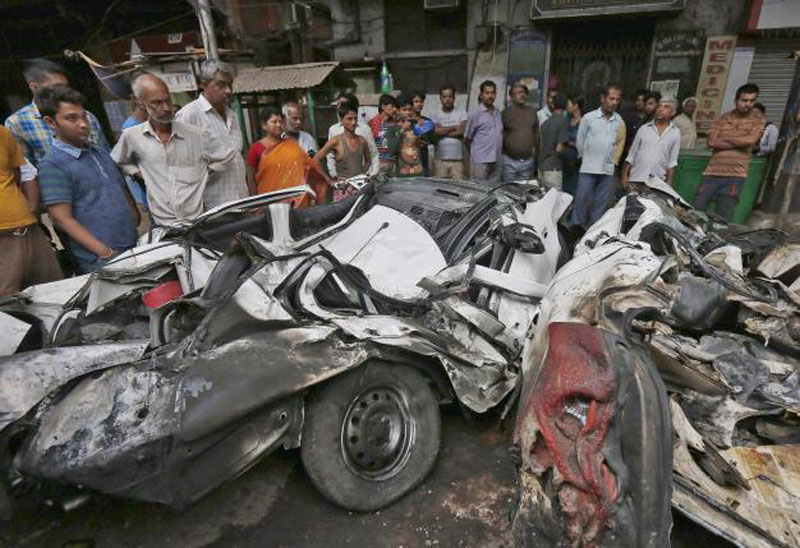 People look at wreckage caused when an under-construction flyover collapsed in Kolkata, India, April 1, 2016.Photo: Reuters