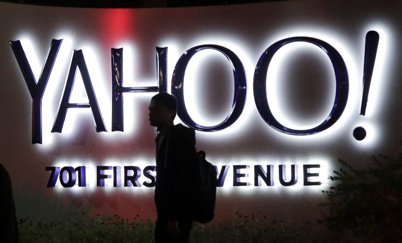 FILE - A person walks in front of a Yahoo sign at the company's headquarters in Sunnyvale, California, on November 5, 2014. Photo: Marcio Jose Sanchez/AP