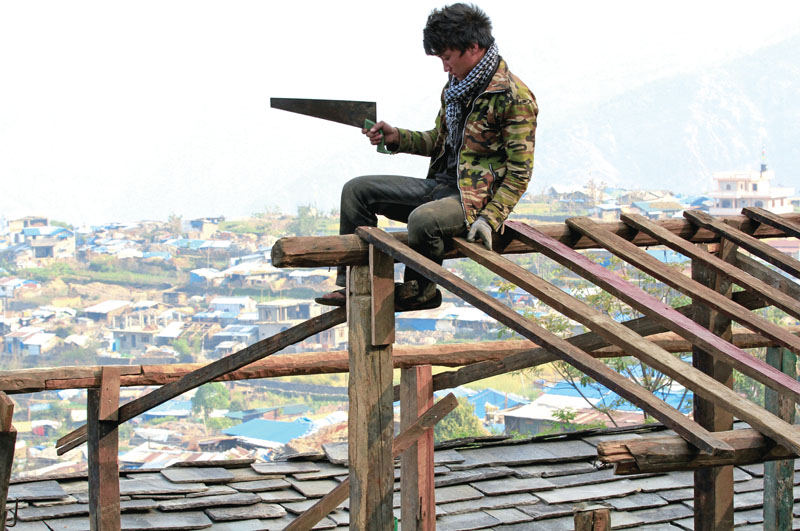 Locals of Barpak village rebuilding their own houses as no government help was forthcoming. Photo: Rajesh Gurung/THT