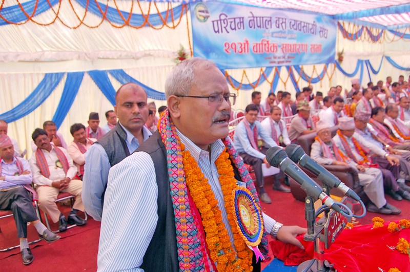 Deputy Prime Minister Bijay Kumar Gachhadar speaking at the 21st Annual General Assembly of West Nepal Bus Entrepreneurs in Sub-Metropolitan City Butwal on Monday, April 11, 2016. Photo: RSS