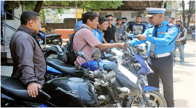 DIG Prakash Aryal shakes hands over lost-and-found motorcycles to their owners in Kathamandu, on Monday, April 18, 2016. Courtesy: MTPD