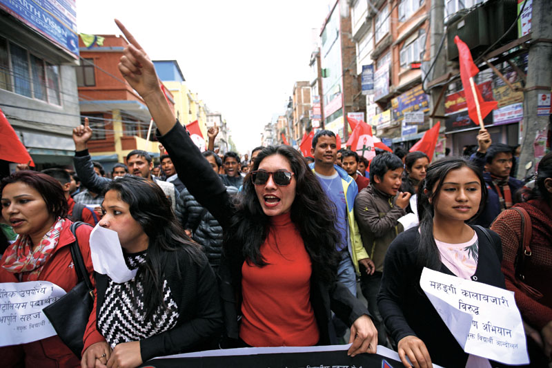 Students chant slogans while staging a street protest against illegal black-marketing in Ratnapark, nKathmandu, on Friday, April 1, 2016. Photo: THT