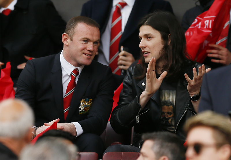 Manchester United's Wayne Rooney and musician James Bay in the standsn during Barclays Premier League game against Everton at Old Trafford on April 3, 2016. Photo: Reuters