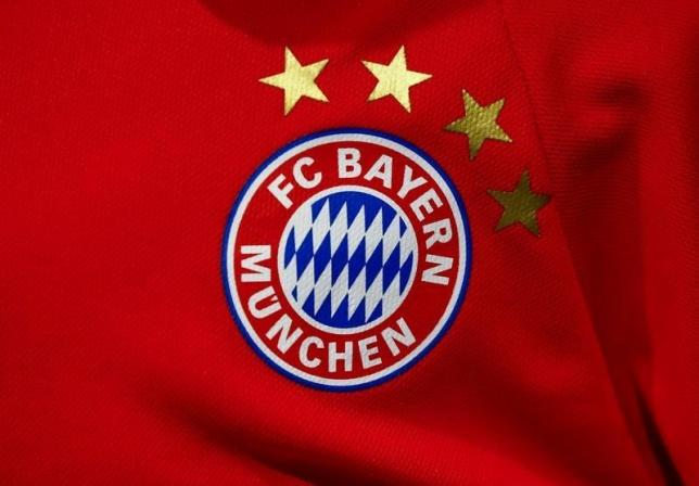 The logo of German first division soccer team Bayern Munich is seen on an official football shirt of Germany's most successful soccer team in Troisdorf near Bonn, western Germany March 9, 2016. Photo: Reuters