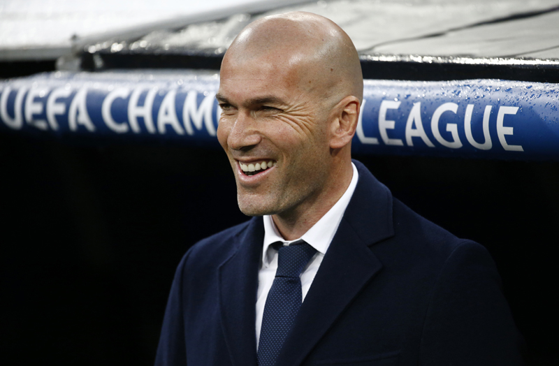 Real Madrid coach Zinedine Zidane smiles during UEFA Champions League 2nd leg quarter finals against Wolfsburg at Santiago Bernabeun on Tuesday, April 12, 2016. Photo: Reuters
