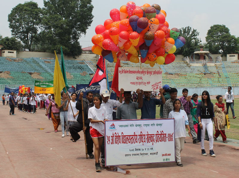 Differently abled athletes and officials take part in march-past during the opening ceremony of the 21st Special Sports Meet at the Dasharath Stadium in Kathmandu on Thursday, May 12, 2016. Photo: THT