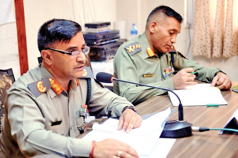 Deputy Inspector General of Armed Police Force Shailendra Khanal (right) addressing a press meet, in Kathmandu, on Tuesday, May 10, 2016. Photo: THT