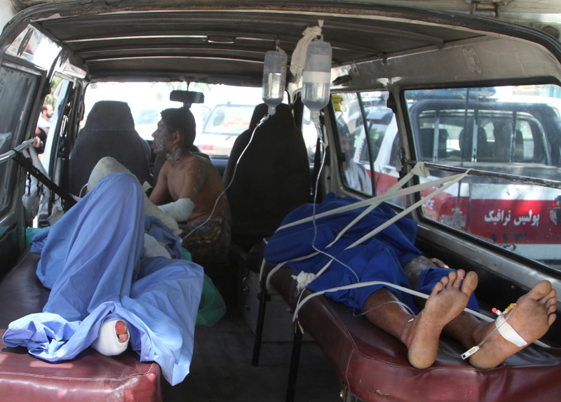 Injured Afghan men lie in an ambulance after an accident on the main highway linking the capital, Kabul, to the southern city of Kandahar, in Ghazni province eastern of Kabul, Afghanistan, Sunday, May 8, 2016. Photo: AP