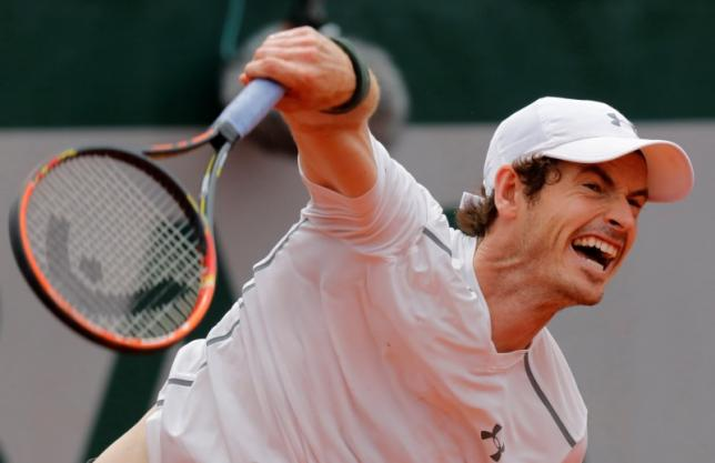 Tennis - French Open - Roland Garros - Ivo Karlovic of Croatia v Andy Murray of Britain - Paris, France - 27/05/16. Murray returns serves. REUTERS/Jacky Naegelen