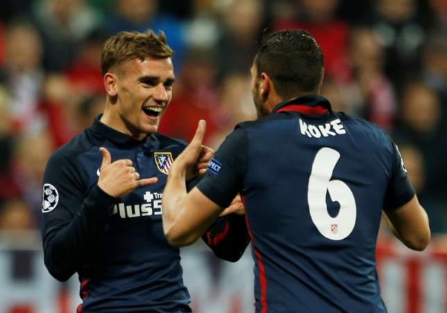 Britain Football Soccer - Bayern Munich v Atletico Madrid - UEFA Champions League Semi Final Second Leg - Allianz Arena, Munich - 3/5/16nAntoine Griezmann celebrates scoring the first goal for Atletico Madrid with KokenReuters / Michaela RehlenLivepic