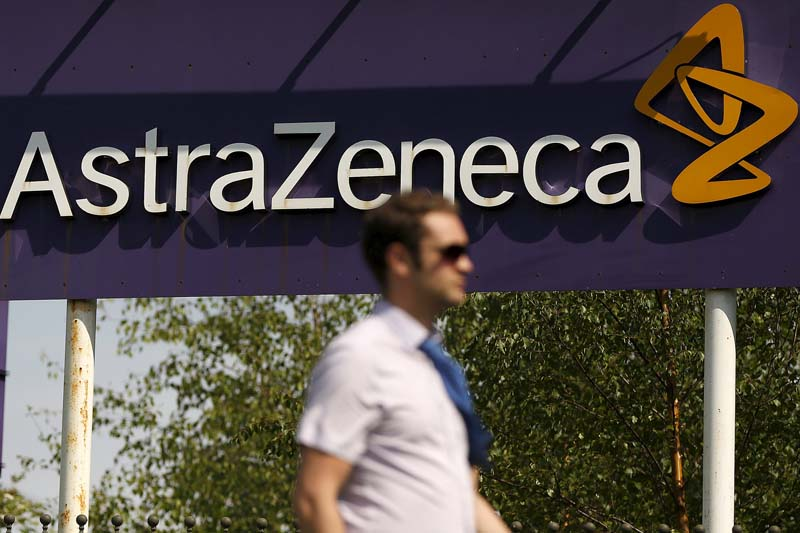 A man walks past a sign at an AstraZeneca site in Macclesfield, central England on May 19, 2014. Photo: Reuters/ File