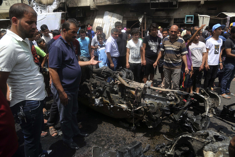 Citizens inspect the scene after a car bomb explosion at a crowded outdoor market in the Iraqi capital's eastern district of Sadr City, Iraq, Wednesday, May 11, 2016. Photo: AP