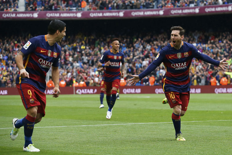 Barcelona's Lionel Messi (right) celebrates with teammates after scoring a goal against Espanyol during their La Liga match in Barcelona on Sunday. Photo: Albert Gea/Reuters
