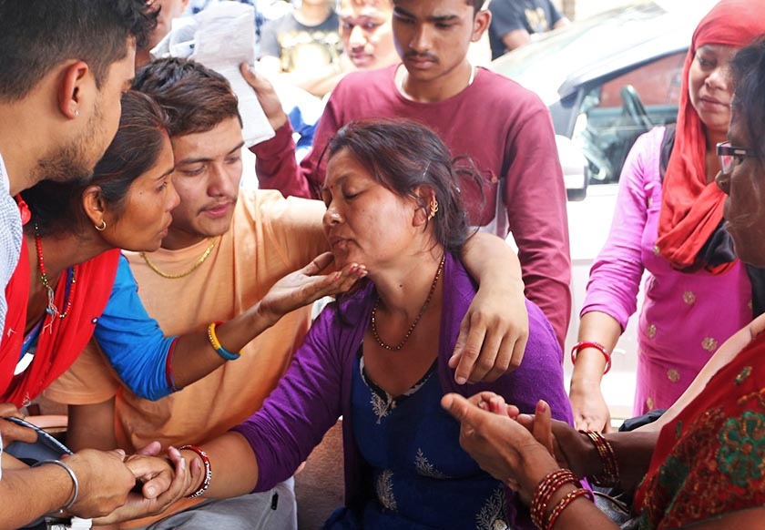 Bimal Gharti Magar and others console  his mother at TUTH, Kathmandu where autopsy of 17-year-old Manisha Gharti Magar, Bimal's sister who was found dead in a suspicious condition at their house in Baradghat on Thursady, was carried out on Friday, May 27, 2016. Photo: RSS
