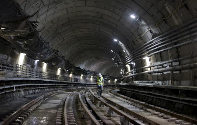 A man walks on the railroad of a metro line extension under construction near Nossa Senhora da Paz station in Rio de Janeiro, Brazil, February 24, 2016. REUTERS/Ricardo Moraes