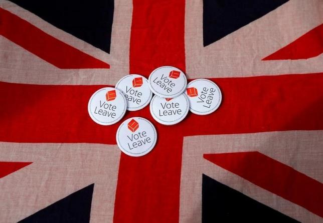Badges are displayed on a Union flag during a Vote Leave rally in Exeter, Britain May 11, 2016.  REUTERS/Darren Staples/File Photo