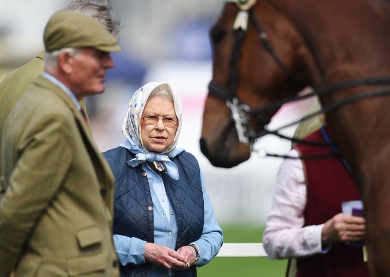 Britain's Queen Elizabeth II looks towards a horse during the Royal Windsor Horse Show, which is held in the grounds of Windsor Castle in Windsor England Thursday May 12, 2016. Queen Elizabeth II is set to celebrate 90th birthday  again. Photo: AP