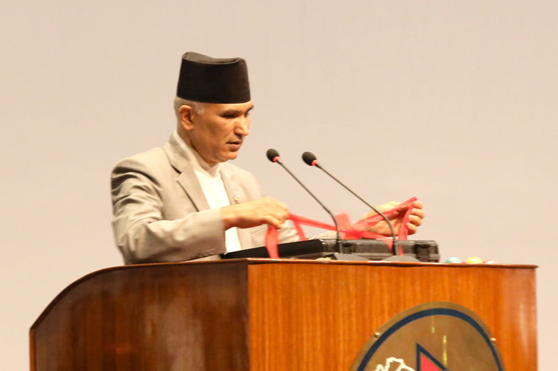 Finance Minister Bishnu Prasad Paudel reads out the annual budget estimates for the Fiscal Year 2016/17 at the at the meeting of the Legislature-Parliament on Saturday, May 28, 2016. Photo: RSS