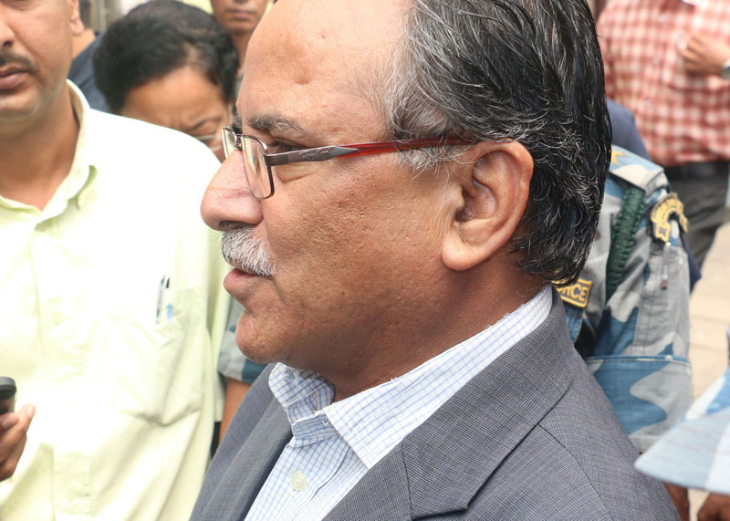 CPN Maoist Centre Chairman Pushpa Kamal Dahal talking to mediapersons after holding a meeting with senior leaders of the major political parties in the Capital on Friday, May 27, 2016. Photo: RSS