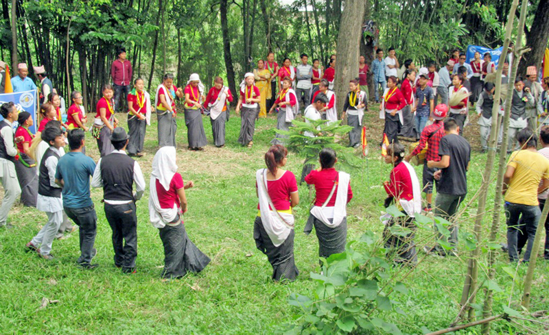 Members of Kirant Community clad in their traditional attires perform the Chandi Nach, in Ithari of Sunsari district. Photo: RSS