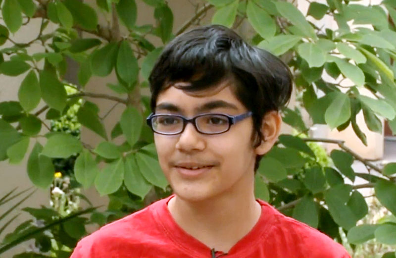 Tanishq Abraham (12) talks about his recent graduation from community college and beginning his university education this fall, in an interview at American River College in Sacramento, California. Photo: KOVR-TV via AP