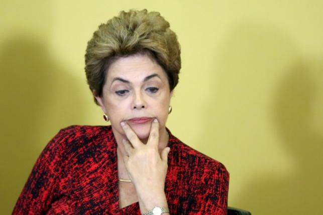 Brazil's President Dilma Rousseff reacts as she attends a signing ceremony for new universities, at Planalto Palace in Brasilia, Brazil, May 9, 2016. REUTERS/Adriano Machado