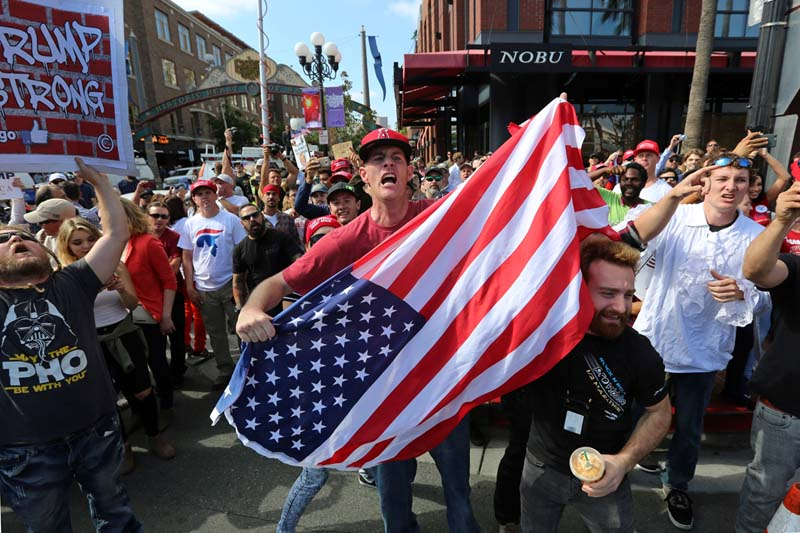 Supporters of Donald Trump shout at anti-Trump demonstrators outside a campaign event for Republican US presidential candidate Donald Trump in San Diego, California, on May 27, 2016. Photo: Reuters