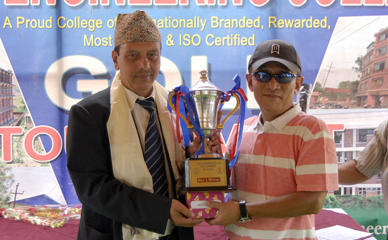 Dr Ranjeet Baral receives the trophy from Executive nChairman of Nepal Engineering College Lambodar Neupane after the NEC Golf Tournament in Kathmandu on Saturday. THT