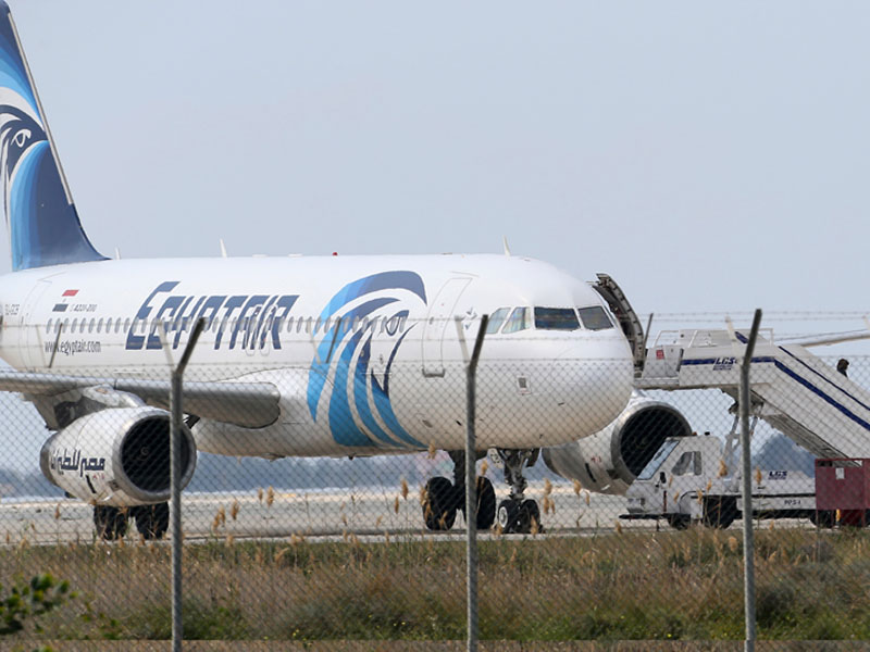 FILE - Passengers leave the hijacked aircraft of Egyptair after landing at Larnaca airport, Cyprus,  on Tuesday, March 29, 2016.  Photo: Petros Karadjias/AP File