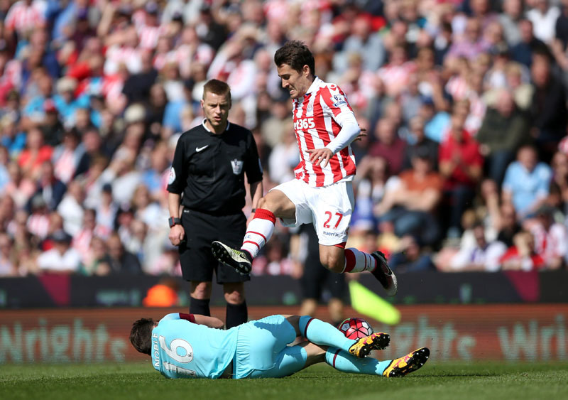 Stoke City's Bojan Krkic, top,  jumps over West Ham United's Mark Noble during their English Premier League soccer match at the Britannia Stadium, Stoke-on-Trent, England, Sunday, May 15, 2016. Photo: Tim Goode/PA via AP