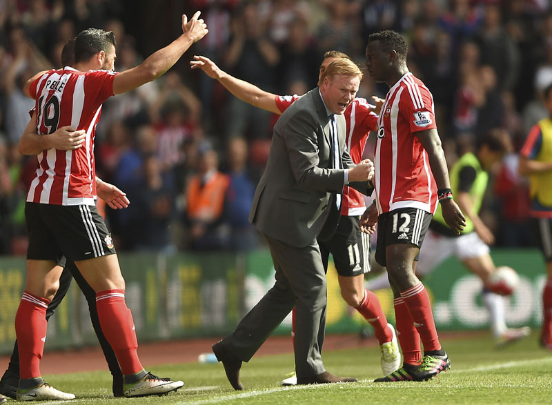 Southampton's Graziano Pelle (left) celebrates scoring his side's second goal as manager Ronald Koeman joins in the festivities during the English Premier League football match between Southampton FC and Crystal Palace at the St Maryu2019s stadium in Southampton , England, on Sunday May 15, 2016 Photo: Daniel Hambury/PA via AP
