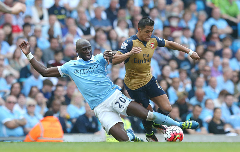 Manchester City's Eliaquim Mangala (left) challenges Arsenal's Alexis Sanchez for the ball during the English Premier League football match at the Etihad Stadium, Manchester, England, on Sunday May 8, 2016. Photo: Tim Goode/PA via AP