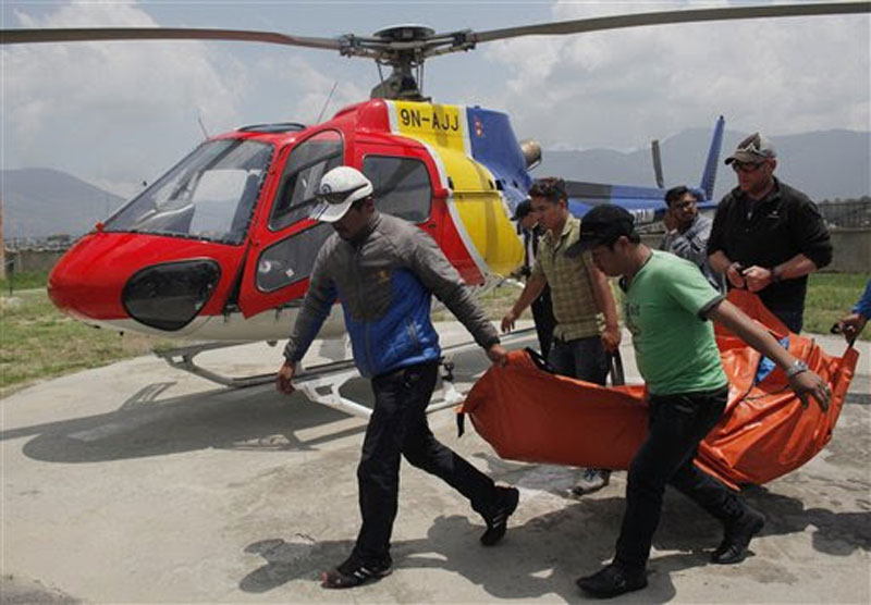 The body of Dutch climber Eric Arnold, who died last week near South Col during a Mount Everest expedition, is carried to Teaching hospital in Kathmandu, Nepal, Thursday, May 26, 2016. AP