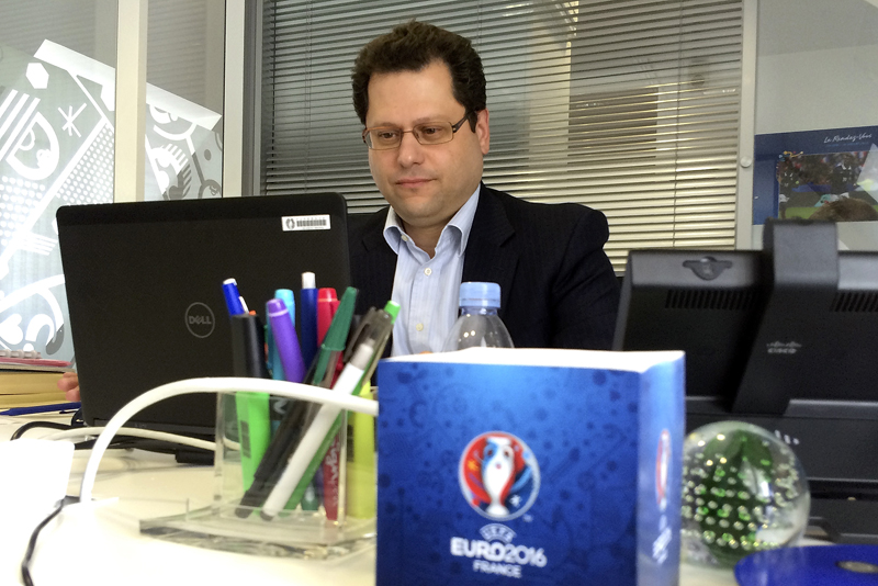 Ziad Khoury, the security director for the Euro 2016 soccer championships, works in his office after responding to questions during an Associated Press interview, Tuesday, May 17, 2016 in Paris. Photo: AP